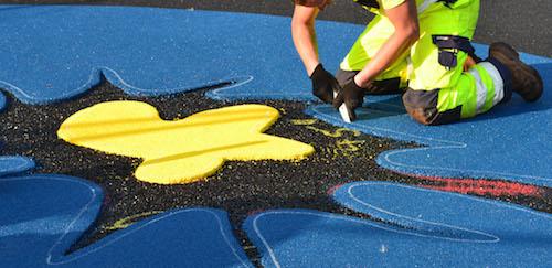 Man installing wetpour graphics