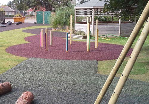 Rubber mulch installed onto grass