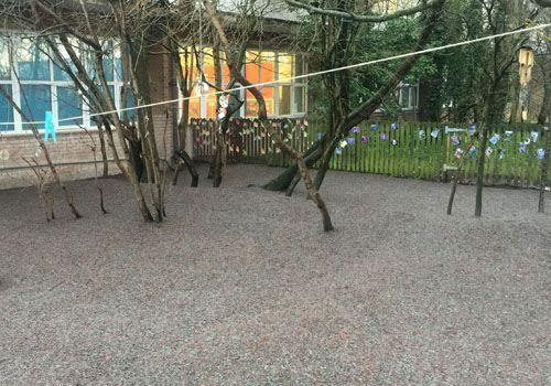 Rubber mulch installed under trees