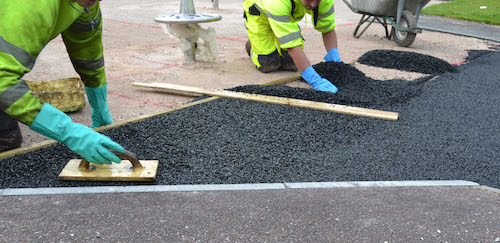 Men installation wet pour surfacing