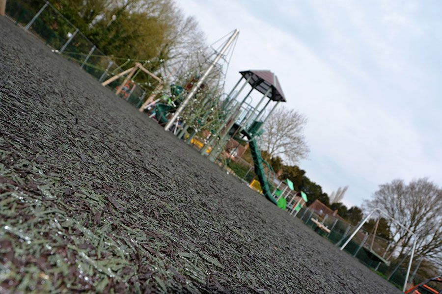 Green and brown rubber mulch at King George Playing Field, Barford