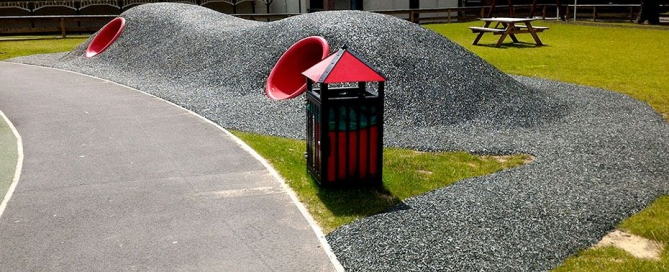 Bonded rubber mulch installed over mounds