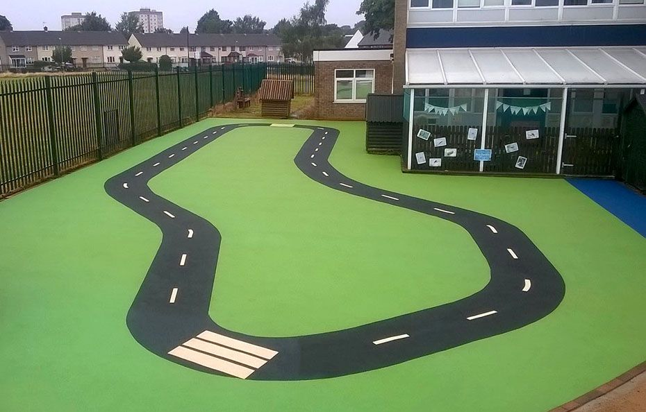 Road design in play surfacing