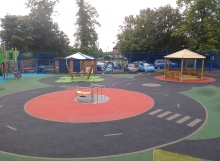 Rigby Hall School - Wet Pour Roundabout - Playground Surfacing